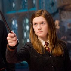 Ginny pointing her wand in the Room of Requiremnt