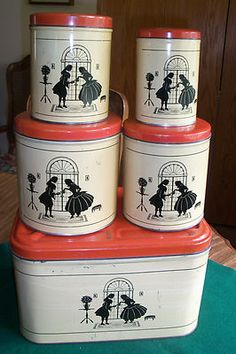 great canister set and bread box.   I've never seen this design before,  Really cute!