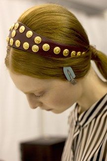Hair Spring Summer 2014: Valentino Low, centre-parted ponytails were accessorised with studded hairbands.
