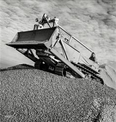 "November 1942. ""Columbia Steel Company at Geneva, Utah. Bulldozer handling gravel for concrete during construction of a new steel mill."""