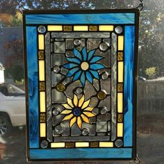 Blue and yellow flowers stained glass window hanging