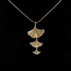 The Ginkgo Necklace from Michael Michaud is cast in bronze from a real ginkgo tree in order to capture every natural detail. This hand-patinaed bronze necklace features three dangling ginkgo leaves of diminishing size for an elegant look. Leaf Jewelry, Cute Jewelry, Jewelry Art, Jewelry Design, Jewlery, Metal Jewellery, Indian Jewelry, Garden Shop, Leaf Pendant