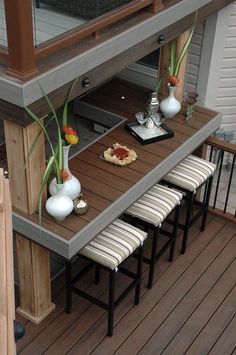 """This cantilevered bar is conveniently located close to the hot tub, and sheltered by the upper deck above. Part of the """"Spiral Staircase Deck"""" on """"Decked Out"""". Deck Design by Paul Lafrance Design."""