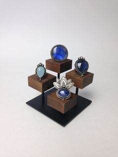 Ring display stand in steel and wood. Display blocks have been sanded, stained and protected by a matte finish polyurethane. The steel base has been