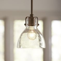 Brixton Pendant | Adjust the height of this dark brushed bronze and clear seeded glass pendant to suit almost any space.