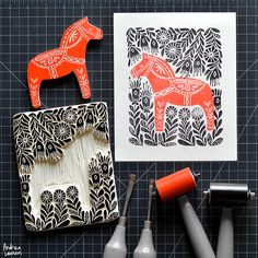Andrea Lauren : Dala Horse She hand draws the illustrations then hand-carves them on natural wood which are then block printed to design silkscreen art print in water-based block printing inks.