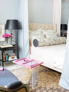 I love the idea of curtains around the bed - great way to keep out light!