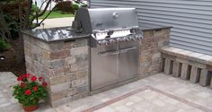 "Wouldn't this built- in outdoor grill & stonework be the ""cat's meow""!?!?"