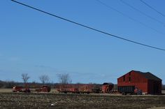 RED UPSTATE NEW YORK BARN AND TRACTORS--TOWN OF HOUNSFIELD----3-17-2013