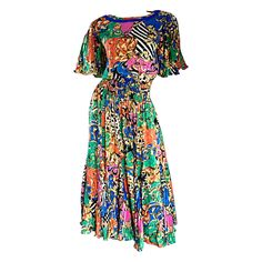 Amazing Vintage Diane Freis Psychedelic Colorful Bohemian Boho Dress | From a collection of rare vintage day dresses at https://www.1stdibs.com/fashion/clothing/day-dresses/