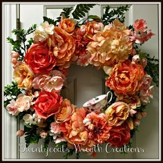 My daughter Elizabeth's Memorial wreath for Mother's Day.  She loved this coral color.  Always a tea cup because she treated me to a Mother/daughter tea and our last outing together was going to the Tea Embassy.