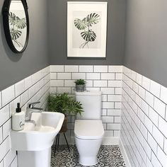 The little room with a wonderfully big tiling solution. bother the metro wall tiles with coloured grout and the patterned floor tiles. Small Downstairs Toilet, Small Toilet Room, Downstairs Cloakroom, Small Toilet Decor, Small Bathroom With Window, Bad Inspiration, Bathroom Inspiration, Toilet Room Decor, Wc Decoration