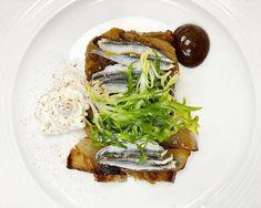 Boquerones (European anchovies) with roasted eggplant and onion in a black garlic aioli, frisée and Spanish sherry foam. Garlic Uses, Black Garlic, Garlic Aioli, Eggplant, Onion, Roast, Spanish, Spanish Language, Onions