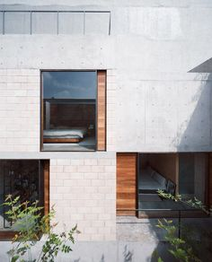 Ambrosi Etchegaray inserts four homes and three courtyards behind an old Mexico City facade