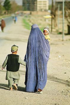 current day Kabul Family walking to where they need to go like most families travel.