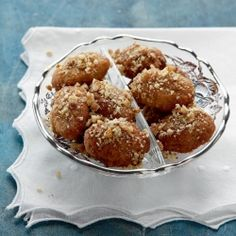 Traditional Greek honey dipped cookies. Let Christmas start rolling!