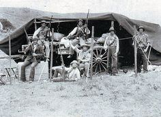 circa Men fighting in the Boer war - relaxing outside their tent and displaying their firearms at Ladysmith in Natal. (Photo by Van Hoepe. Fine Art Prints, Canvas Prints, Framed Prints, Soldier 10, African History, Churchill, Heritage Image, Poster Size Prints, Photo Mugs
