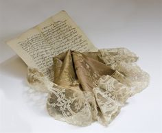 Fragment of puce silk and lace worn by Marie Antoinette while she was imprisoned in the Temple.