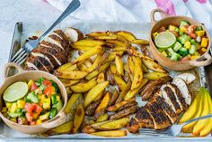 Eat Clean: Sheet Pan Jerk Chicken with Baked Fries + Fresh Mango Salsa!