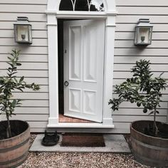 Perfect symmetry: the Georgian style modern entry of Cameron Kimber's Australian country house is painted Dulux Cashmere with the front door In Dulux Whisper White; garden tubs and gravel from local hardware supplier,. Exterior Color Schemes, Exterior Paint Colors, Exterior House Colors, Paint Colors For Home, Exterior Design, Colour Schemes, Australian Country Houses, Modern Country, Country Style