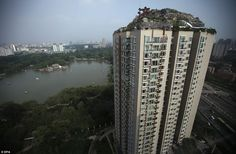 Beijing - Professor zhang lin builds dream mountain villa where he can get away from it all. Only problem is, it's on top of a Beijing apartment block and he never got permission to build in the first place.