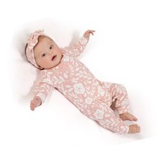 Newborn Girl Take Home Outfit.  Baby Girl Romper & Optional Matching Headband or Beanie.  Easy pull on romper with pink floral print that seems to flutter in the breeze. Optional matching bow tie headband.  100% stretch cotton rib keeps baby girl oh-so-comfy!   Snaps at bottom for changing ease. He