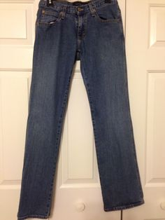 Calvin Klein Size 4 straight leg jeans. So cute and comfortable, but I never took the time to get them hemmed to a shorter length. $20 shipped