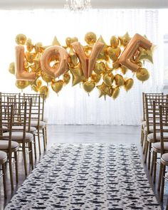 """How fun is this Wedding Ceremony Backdrop? The balloons gave the wedding a youthful and modern vibe. If you're not into a word like """"Love,"""" your new joint initial in an oversize inflatable would work, too. Wedding Backdrop Design, Rustic Wedding Backdrops, Wedding Ceremony Backdrop, Wedding Arches, Wedding Ideas, Wedding Reception, Wedding Simple, Reception Ideas, Wedding Blog"""