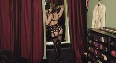 Racy: Daisy flashes her bum in one of the looks, as she dons strappy lingerie to showcase ...