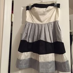 Stripped pleated dress Worn once silky white, grey/silver, and black skater dress. It is so cute and the tag says size 3 but will fit a 4 or 2.  Wishes, wishes, wishes Dresses