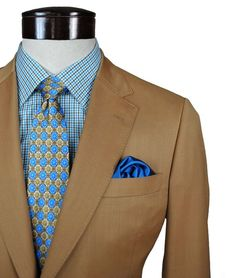 STYLE TIP: Mixing #neutrals with bold colors are a stylish way to approach #fallfashion. #mensfashion #suit #tie #dapper #style #menswear #gentleman #fashion #Elevee #EleveeLifestyle #bespoke