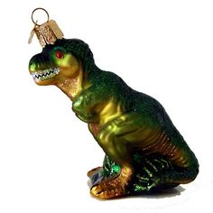 """T-Rex Christmas Ornament 12368 Merck Family's Old World Christmas Introduced 2012 Made of mouth blown, hand painted glass. Ornament measures approximately 4"""" T. rex: Tyrannosaurus"""