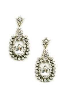 Get vintage with these glamorous drops of beautiful crystal engraved onto a vintage gold finish. These earrings are perfect for a romantic gala or a special date night. The earrings are approximately 2 inches in length.