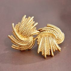 Excellent condition, vintage 1960s Monet, gold tone, fireworks, abstract twisted rope, clip on earrings. Part of the Mirador Collection. Monet Patd