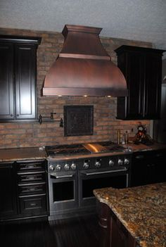 A Traditional Space Accented With A Smooth Finished Copper Vent Hood.
