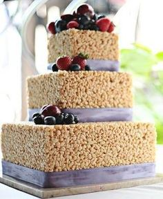 "Rice Krispie Cake. LOVE this idea....if someone told me this without a picture I would have thought ""trashy"" but this looks really nice for a casual wedding."