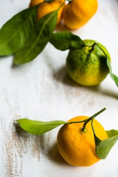 Pic: Ripe tangerine with green leaves