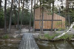 Built by FAM Architekti,Feilden+Mawson in Doksy, Czech Republic with date 2014. Images by Tomas Balej. The replacement of an old cabin on a lake shore in Norther Bohemia respects the unique natural character of the site ...