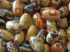 You can make paper beads that look like fired ceramic beads.