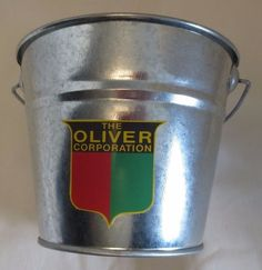 "NEW OLIVER ""THE OLIVER CORPORATION SHIELD GALVANIZED PAIL LOGO USED 1945-1960"