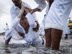Balinese devotees celebrate Melasti purification festival