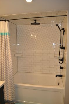 Guest bathroom redo:White subway tile shower with grey grout. Black Kingsley fixtures by Moen. White Tiles Grey Grout, White Subway Tile Bathroom, Subway Tile Showers, Bathroom Black, Upstairs Bathrooms, Grey Bathrooms, Laundry In Bathroom, Casa Rock, Shower Fixtures