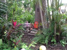 Princess miss Fairy Cordyline talking to possum Poe in the Secret Fairy Garden