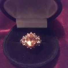 SALE Very Beautiful  Madera. Citrine Ring Large Oval cut Deep Amber colored, Madera Citrine. Rich in color.. 12x10. Oval Center stone surrounded by round gems in this deep color.  NWOT.            Set in 925 Sterling Silver Citrine Marvels Jewelry