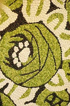 green and white floral art using BEANS  - cool!