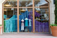 Anthropologie store window -use tissue paper strips for the spring display case.
