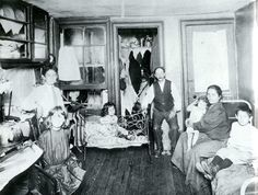 Poor Family in Room of Tenement Apartment. New York City — Poor family in one room tenement apartment — Photo by Jacob Riis, Image © Bettmann/Corbis Lower East Side, Us History, American History, Family History, Vintage Pictures, Old Pictures, Photos Du, Old Photos, Antique Photos