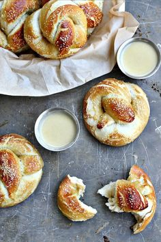 Beer Pretzels with Drunken White Cheddar Sauce. These golden pillow-y beer pretzels are salted and hardened on the outside, but soft and chewy on the inside. Served with a white cheddar beer sauce, it's perfection all around. | Killing Thyme #beer #pretzels #gameday #tailgaterecipes #gamedayrecipes