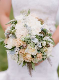 Love this soft bouquet! White cabbage roses, ornamental grasses, queen annes lace, Japanese spray roses, succulents, balsa wood flowers, sahara roses, nandina foliages, gooseneck loosestrife, white yarrow, scabiosa pods, white peony, and nigella pods.