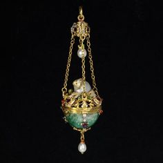 Enamelled gold set pendant with an emerald, rubies, baroque pearl and pearls. 1860-1880